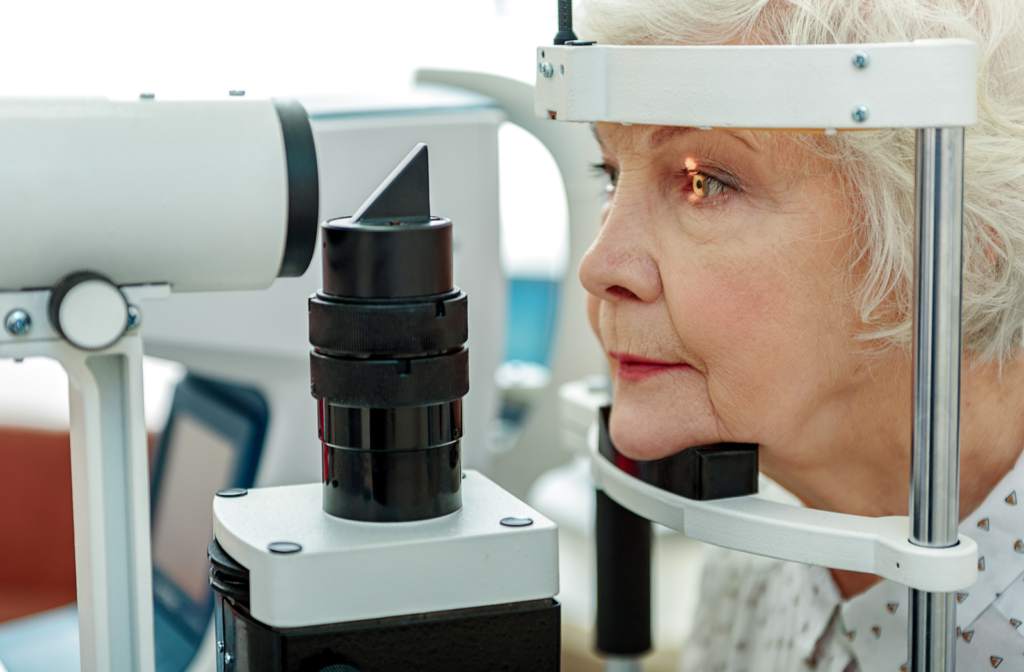 Senior woman sitting in front of machine during tonometry test for glaucoma