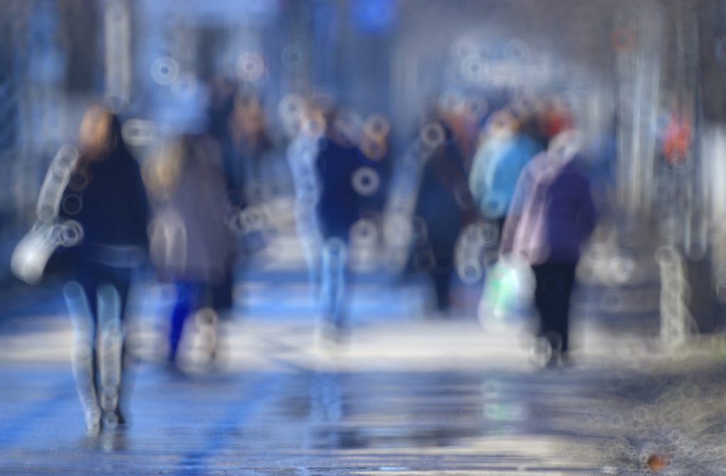 Blurry vision in the city as people are walking.